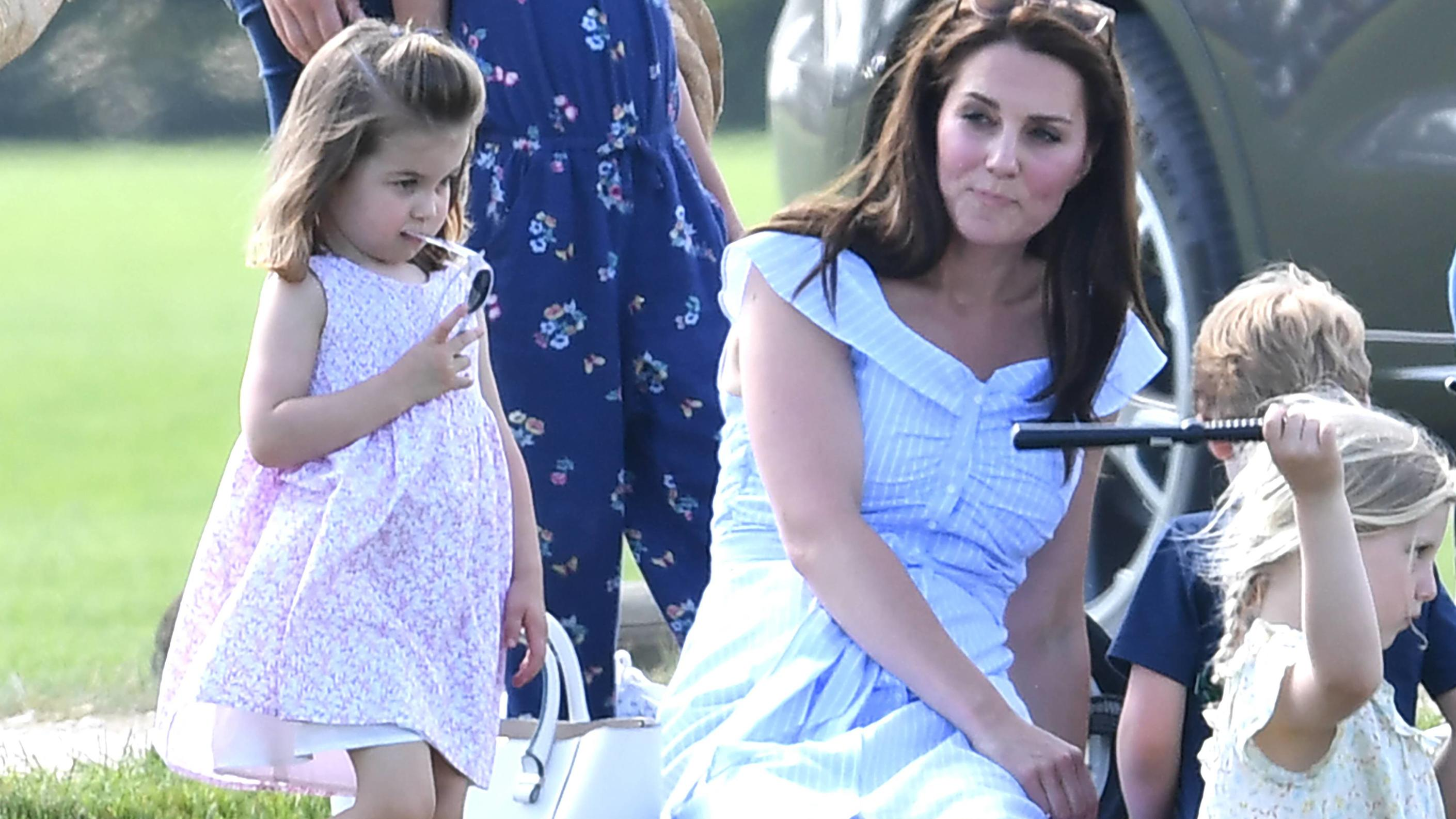 Maserati Royal Charity Polo Trophy Catherine Duchess of Cambridge, Prince George and Princess Charlotte watch on as Prince William Duke of Cambridge plays Polo at the Gloucestershire Festival of Polo, the Beaufort Club, . Photo credit should read: Do
