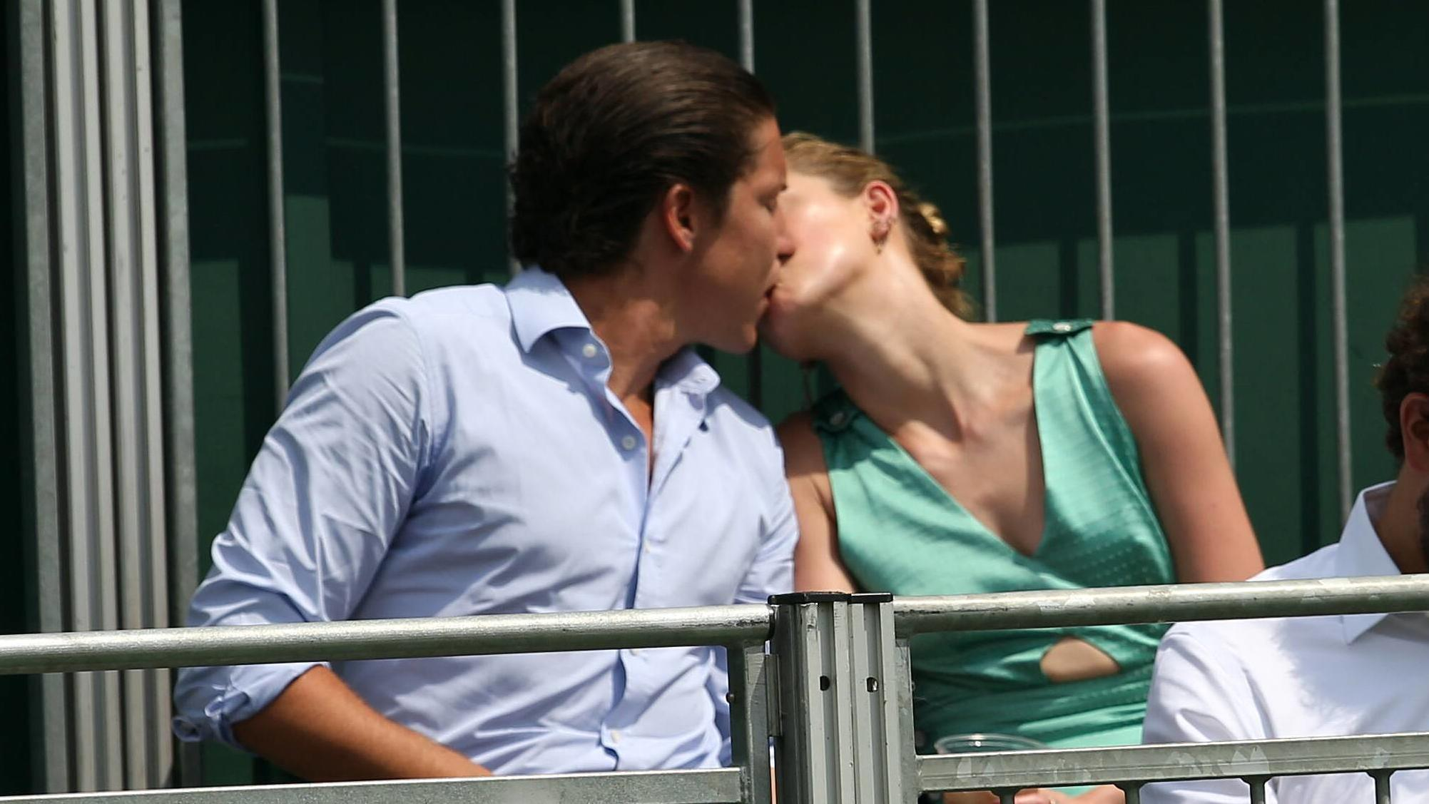 LONDON, ENGLAND - JULY 07: it s official THEY HAVE THEIR FIRST KISS Amber Heard wearing a low cut mint jumpsuit with new boyfriend Vito Schnabel attend day seven of the Wimbledon Tennis Championships at the All England Lawn Tennis and Croquet Club on