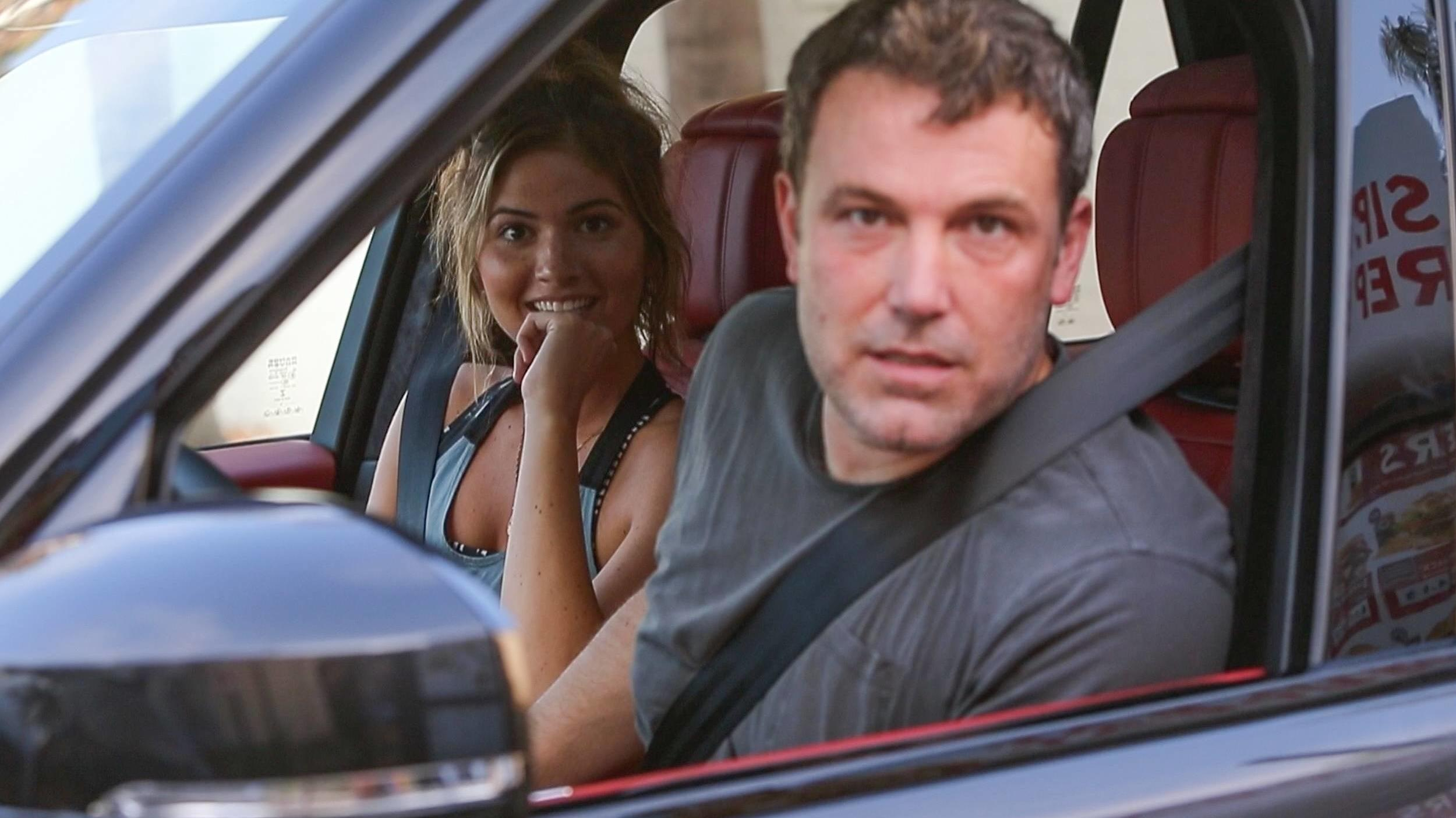 Ben Affleck and rumored new girlfriend Shauna Sexton grab some fast food as the pair are seen together for the first time. The alleged couple are all smiles as they order at the drive through at Jack in the Box. The model looks fresh faced and casual