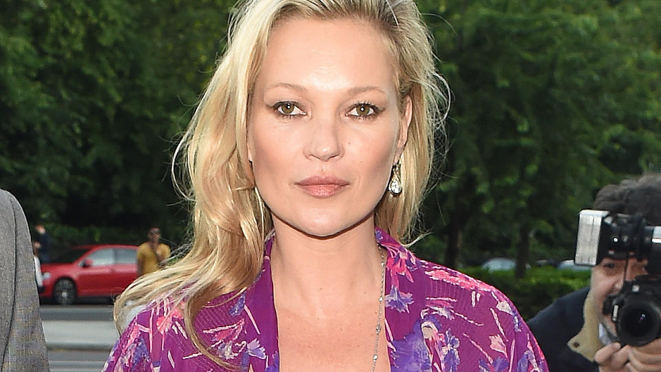 Kate Moss seen arriving at the Victoria and Albert Museum Summer Party. Kate was pictured wearing a purple jumpsuit. upon arriving Kate was seen flashing her bra as she stepped out of her car.Featuring: Kate MossWhere: London, United KingdomWhen: 23