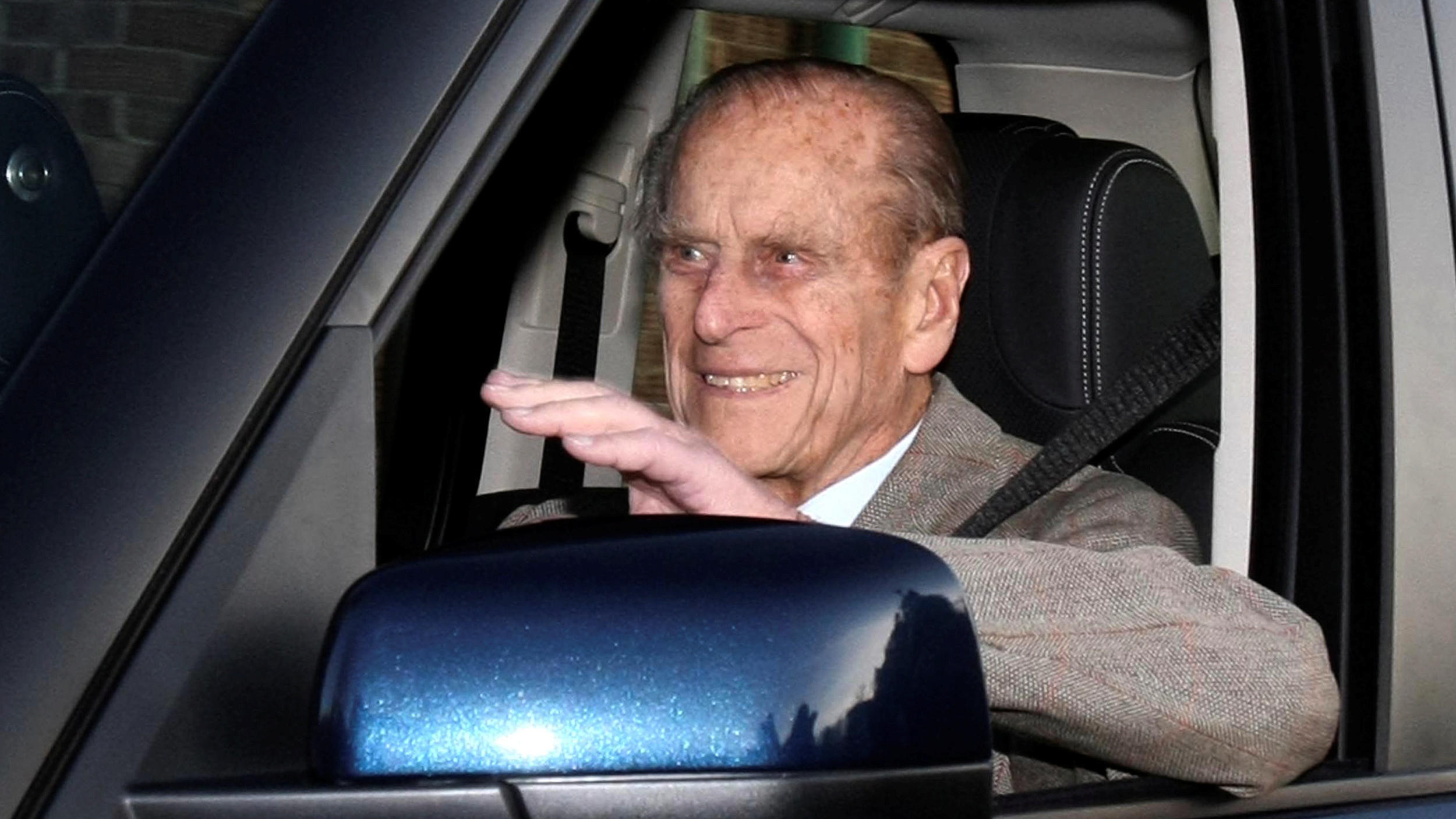 FILE PHOTO: Britain's Prince Philip is driven away from Papworth Hospital in southern England December 27, 2011.-   REUTERS/Neil Hall/File Photo