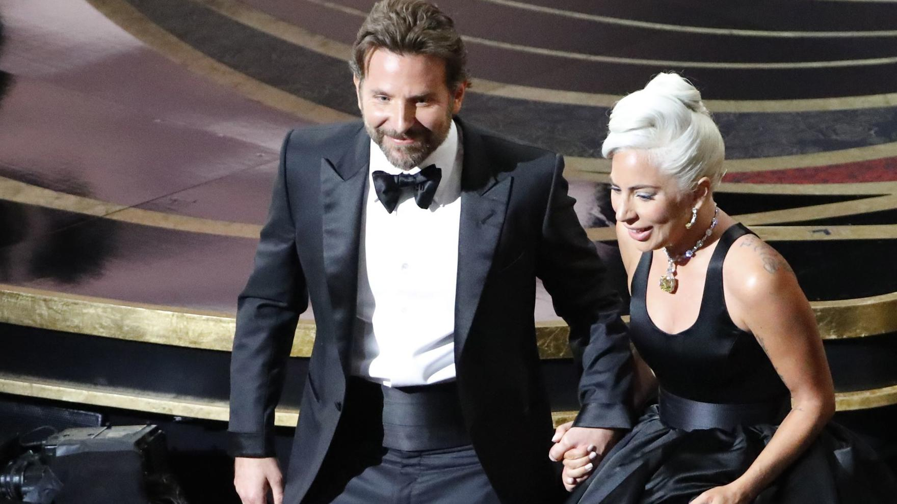 "91st Academy Awards - Oscars Show - Hollywood, Los Angeles, California, U.S., February 24, 2019. Lady Gaga and Bradley Cooper depart the stage after performing ""Shallow"" from ""A Star Is Born."" REUTERS/Mike Blake"
