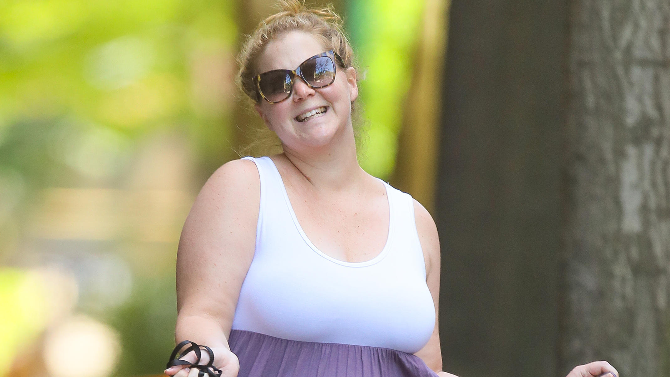 Amy Schumer is all smiling while dancing as walking her puppy in New York CityPictured: Amy SchumerRef: SPL5091227 180519 NON-EXCLUSIVEPicture by: Felipe Ramales / SplashNews.comSplash News and PicturesLos Angeles: 310-821-2666New York: 212-619-2666L