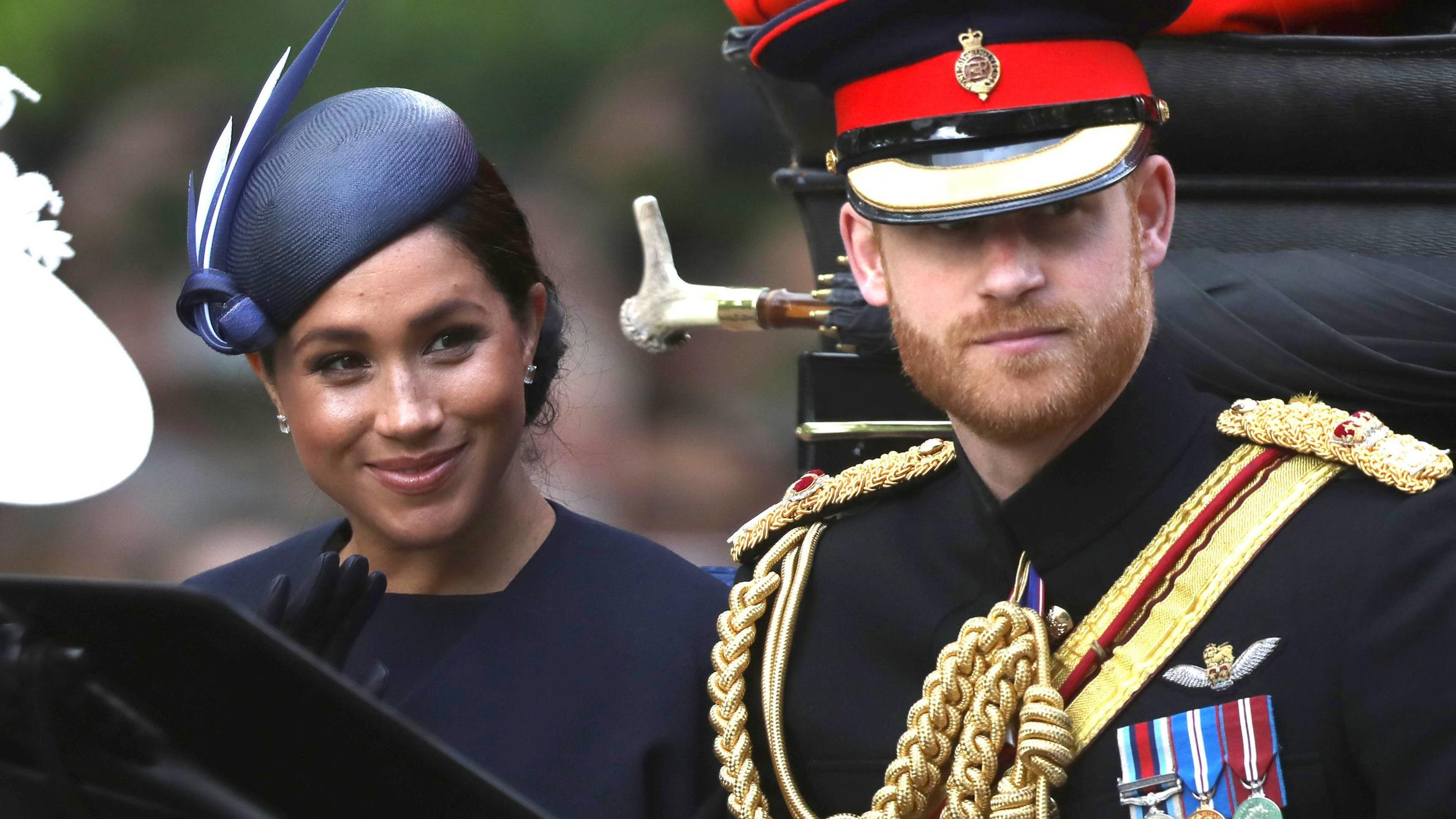 Meghan Markle (Duchess of Sussex), Prince Harry (Duke of Sussex), in a carriage on their way to Horse Guards Parade at the Trooping of the Colour 2019. Trooping the Colour marks the Queens official birthday and 1,400 soldiers, 200 horse and 400 music