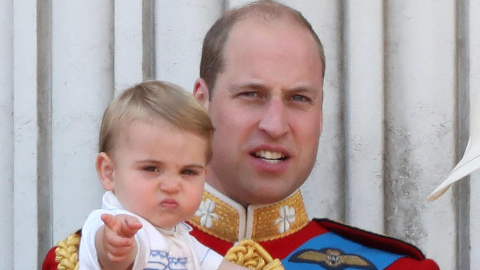 Prince William (Duke of Cambridge), holding Prince Louis, pictured at the Trooping of the Colour 2019. Trooping the Colour marks the Queens official birthday and 1,400 soldiers, 200 horse and 400 musicians parade for Queen Elizabeth II, and the event