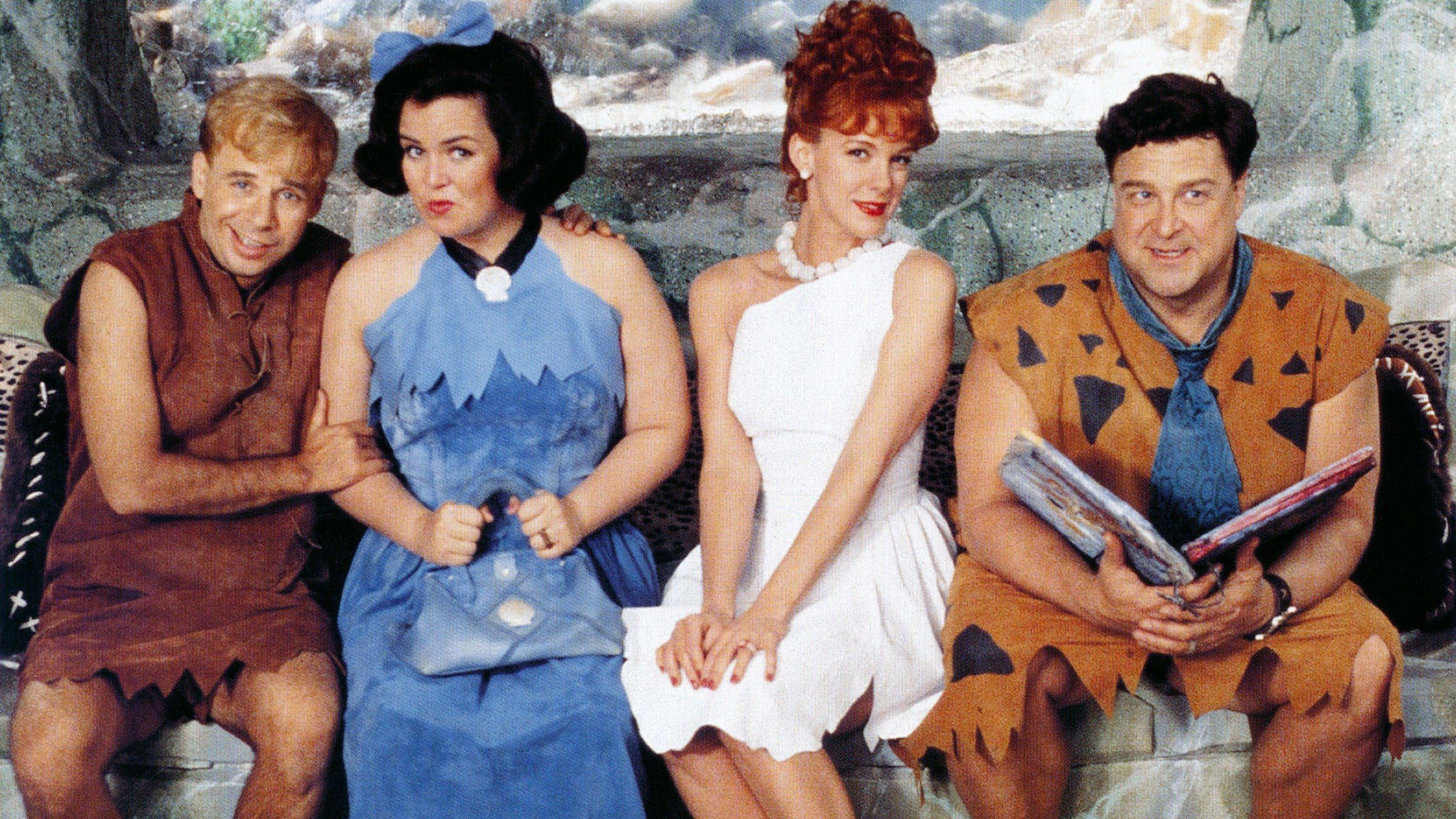 THE FLINTSTONES, from left: Rick Moranis, Rosie O'Donnell, Elizabeth Perkins, John Goodman, 1994, © Universal/courtesy Everett collection