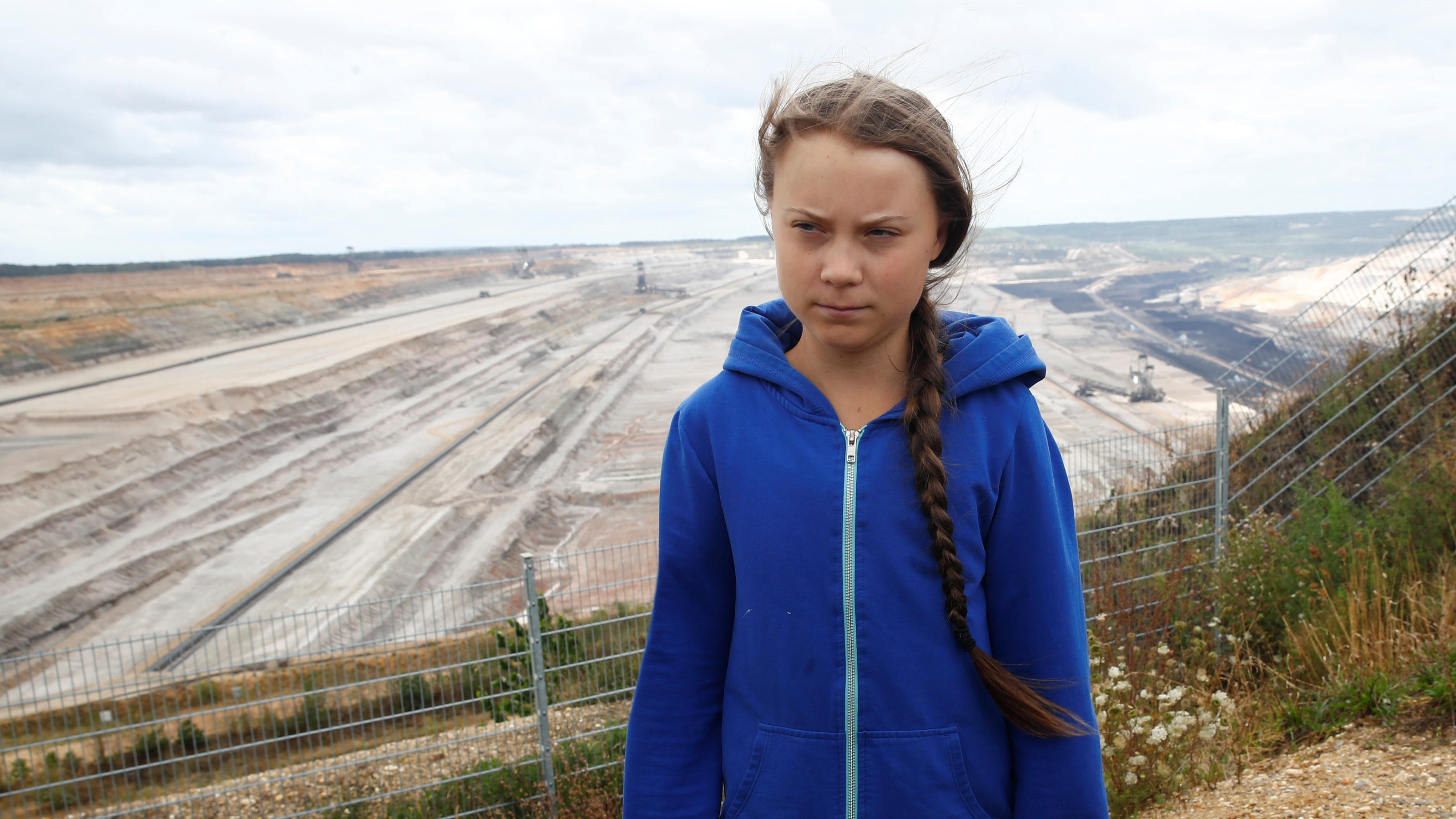 "Greta Thunberg, Swedish ""Fridays for Future"" climate activist, stands at the edge of the Hambach open-cast brown coal mine of German utility RWE, west of Cologne, Germany, August 10, 2019.   REUTERS/Wolfgang Rattay"