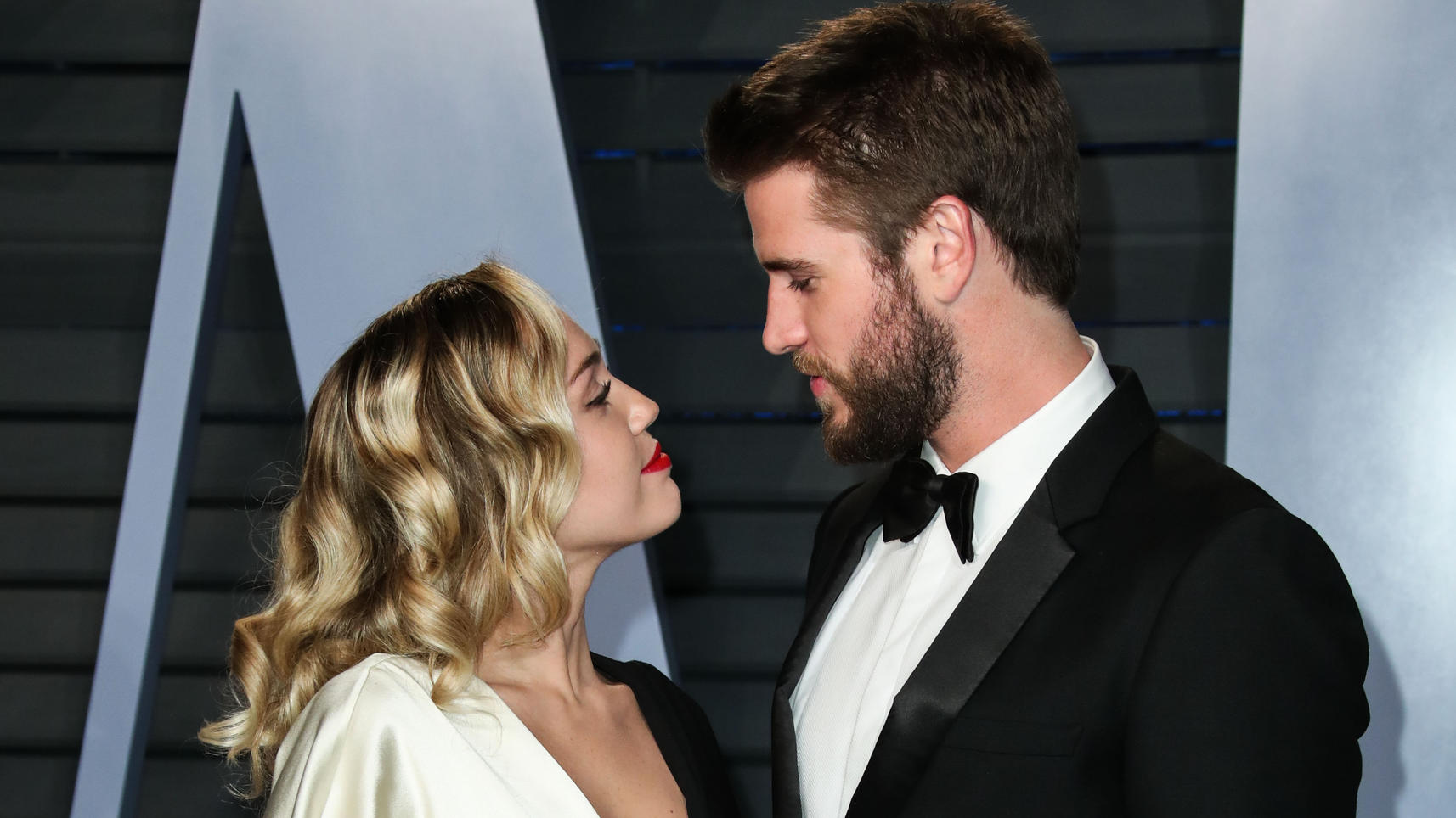 (FILE) Miley Cyrus and Liam Hemsworth Split. BEVERLY HILLS, LOS ANGELES, CALIFORNIA, USA - MARCH 04: Singer Miley Cyrus and boyfriend/actor Liam Hemsworth arrive at the 2018 Vanity Fair Oscar Party held at the Wallis Annenberg Center for the Performi
