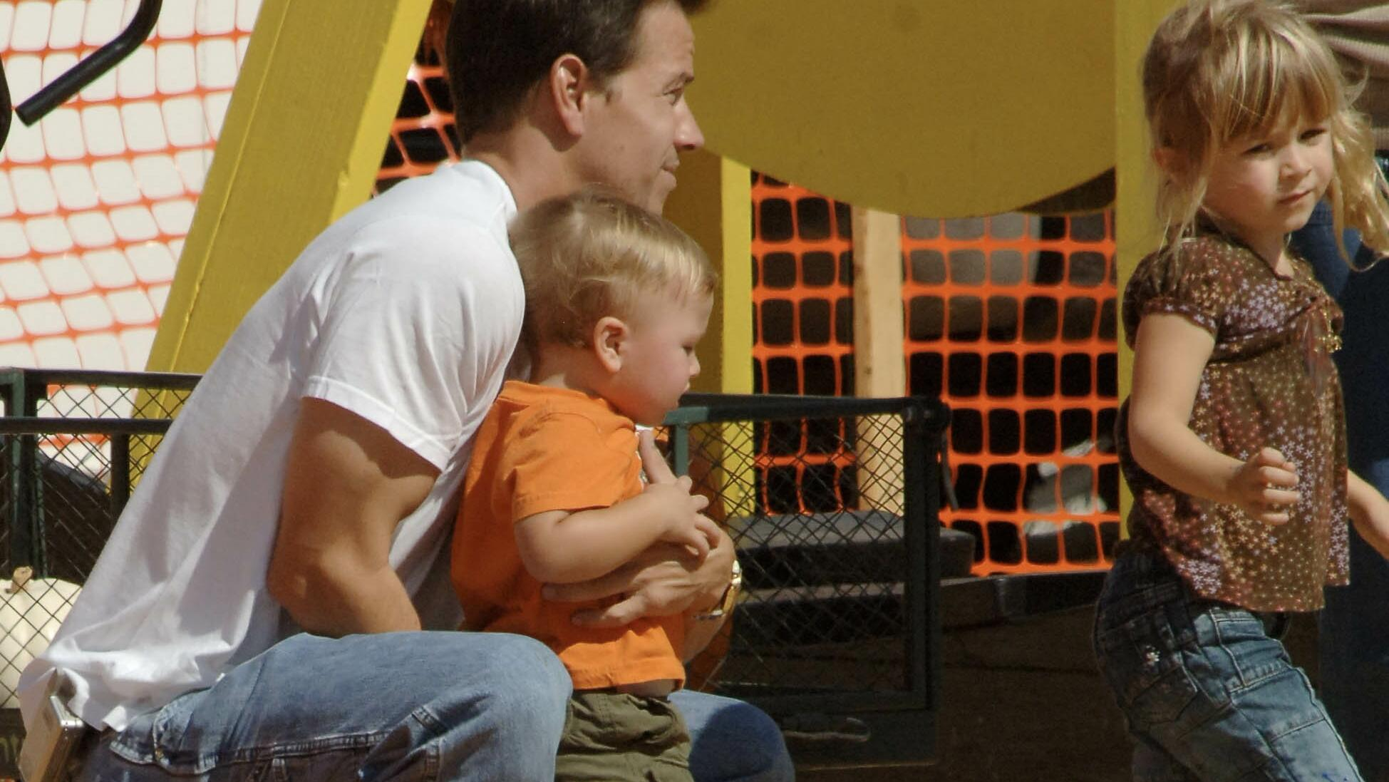 Mark Wahlberg gets mobbed by the paparazzi as he spends the afternoon at Mr Bones Pumpkin Patch in West Hollywood, Ca with girlfriend Rhea Durham and their young children Michael and Ella