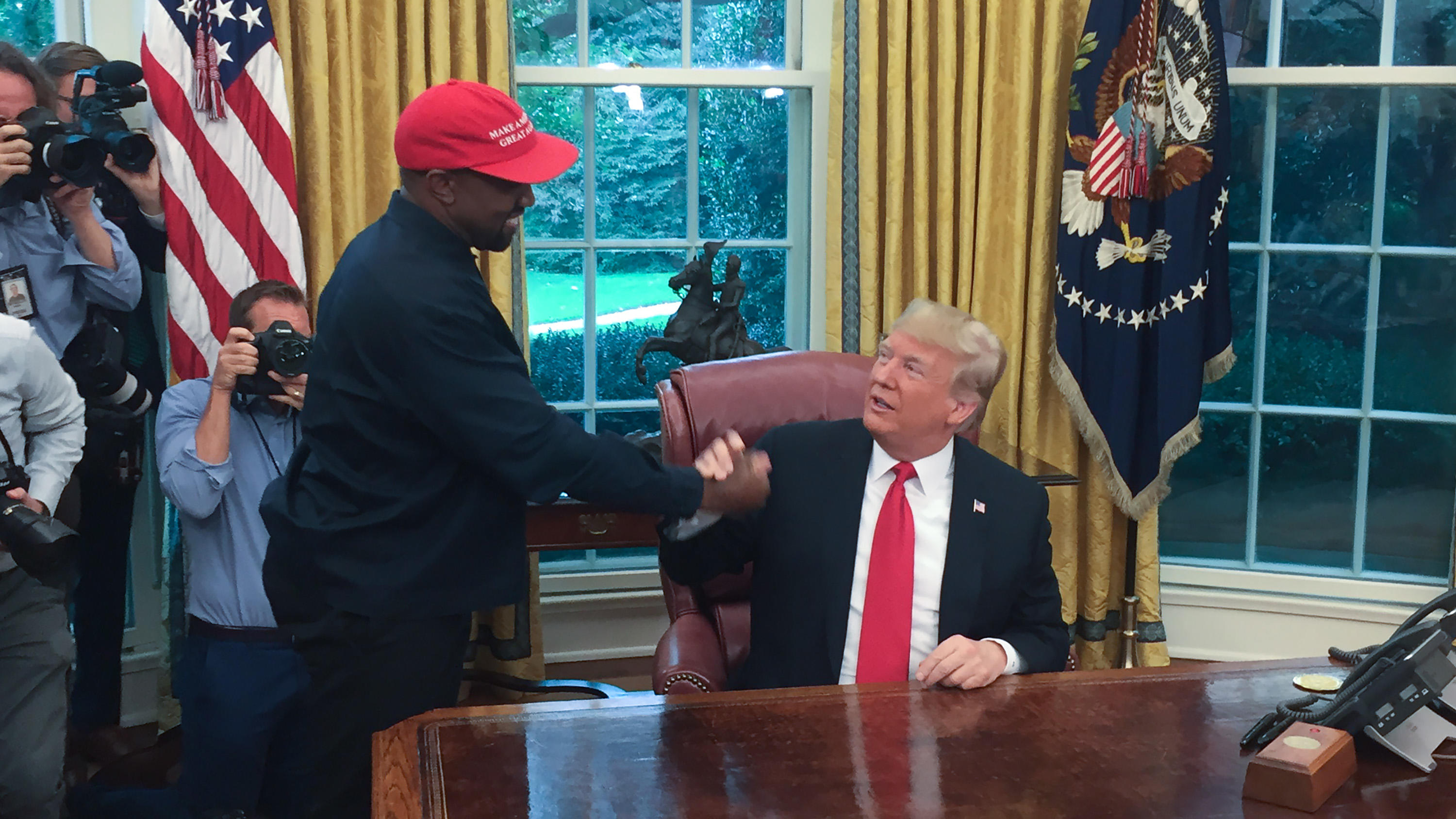 (Files) in this file photo US President Donald Trump meets with rapper Kanye West in the Oval Office of the White House in Washington, DC, October 11, 2018. - Rapper Kanye West, who has been outspoken in his support for President Donald Trump, now sa