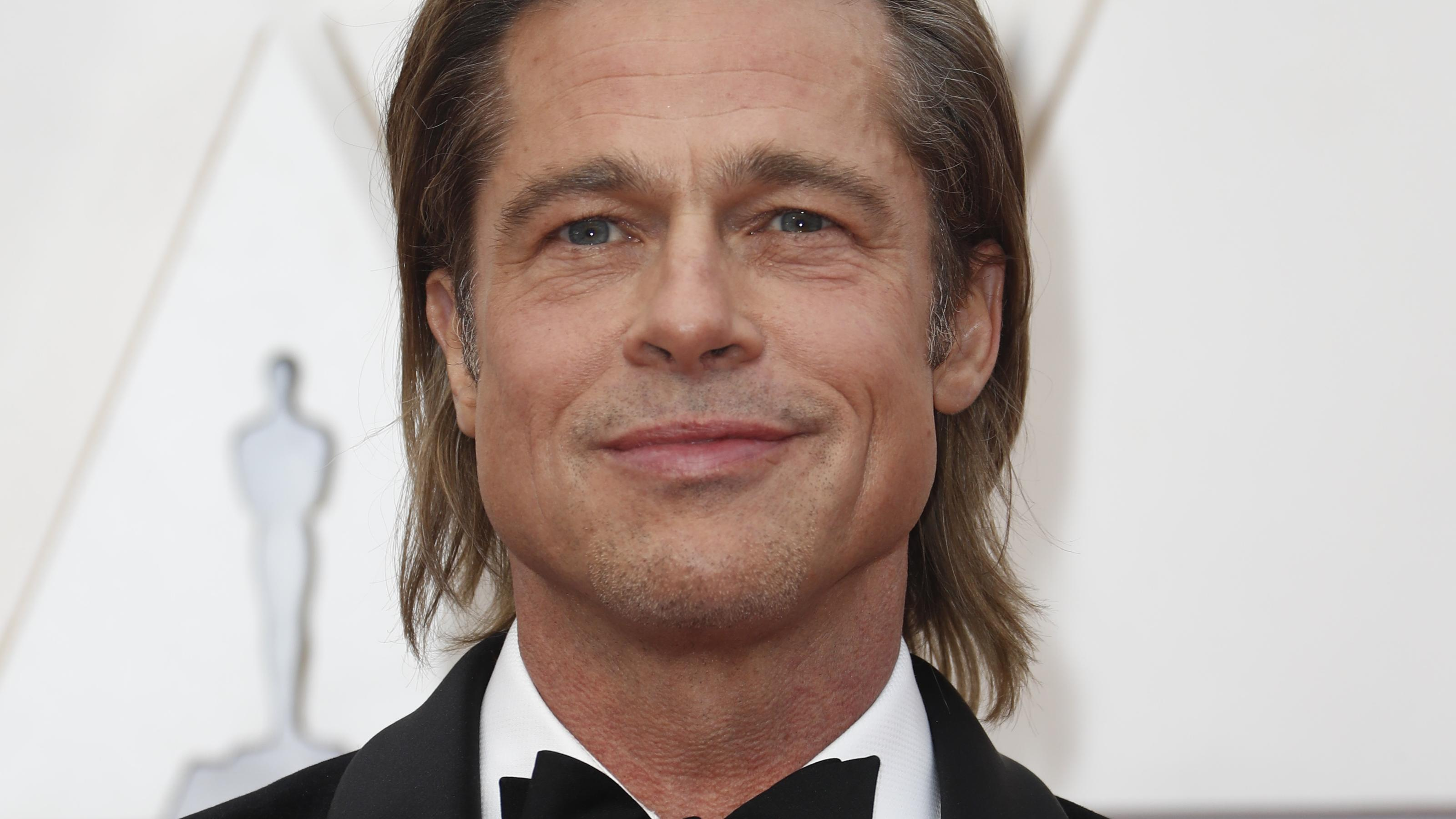 Brad Pitt poses on the red carpet during the Oscars arrivals at the 92nd Academy Awards in Hollywood, Los Angeles, California, U.S., February 9, 2020. REUTERS/Eric Gaillard