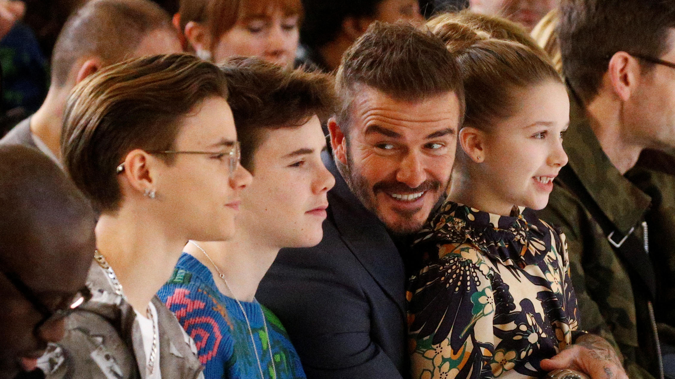 David Beckham, with his children Romeo, Cruz and Harper,  at the Victoria Beckham catwalk show during London Fashion Week in London, Britain, February 16, 2020. REUTERS/Henry Nicholls
