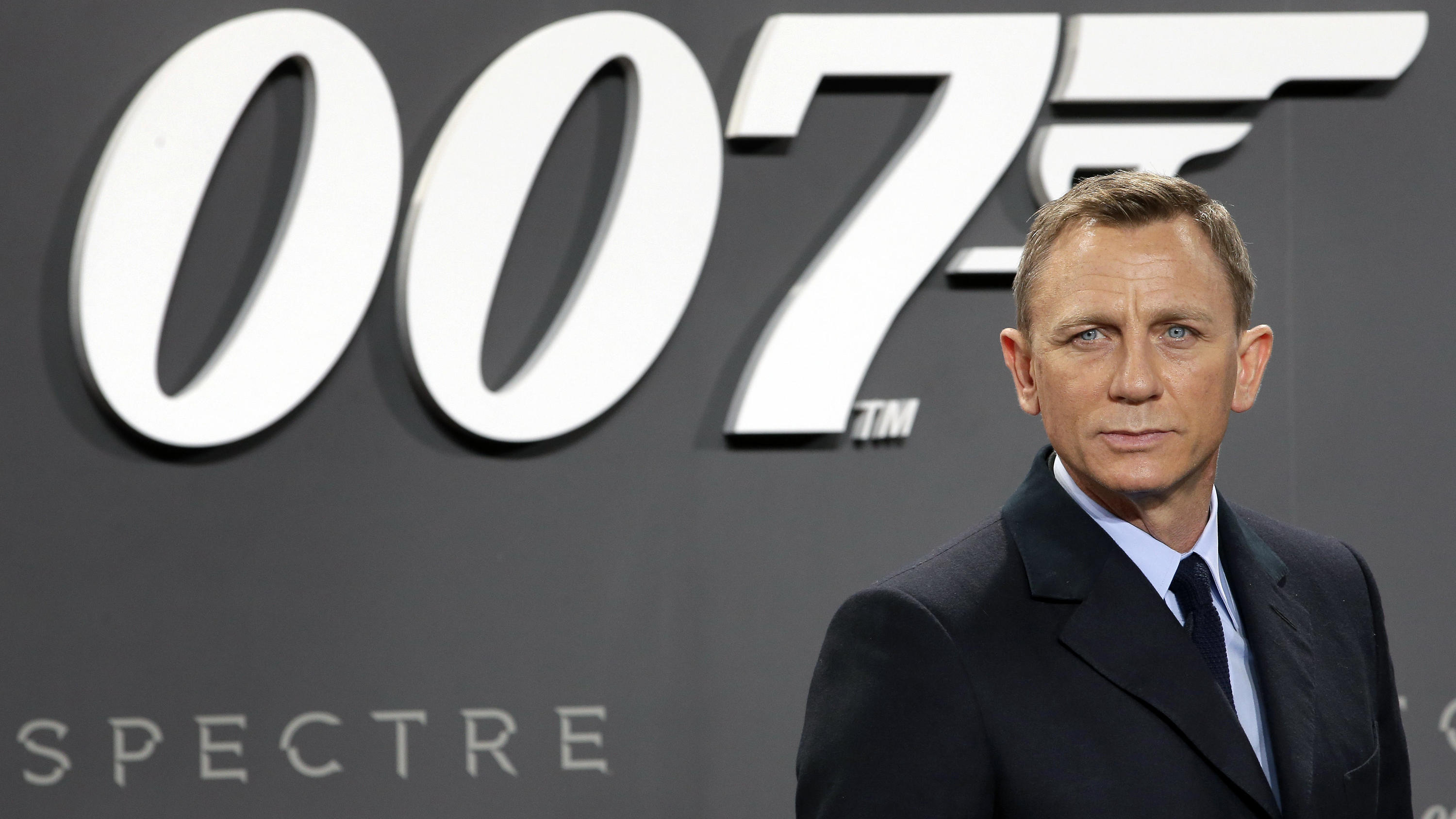 "FILE - This is a Wednesday, Oct. 28, 2015 file photo of actor Daniel Craig poses for the media as he arrives for the German premiere of the James Bond movie 'Spectre' in Berlin, Germany. The release of the James Bond film ""No Time To Die"" has bee"