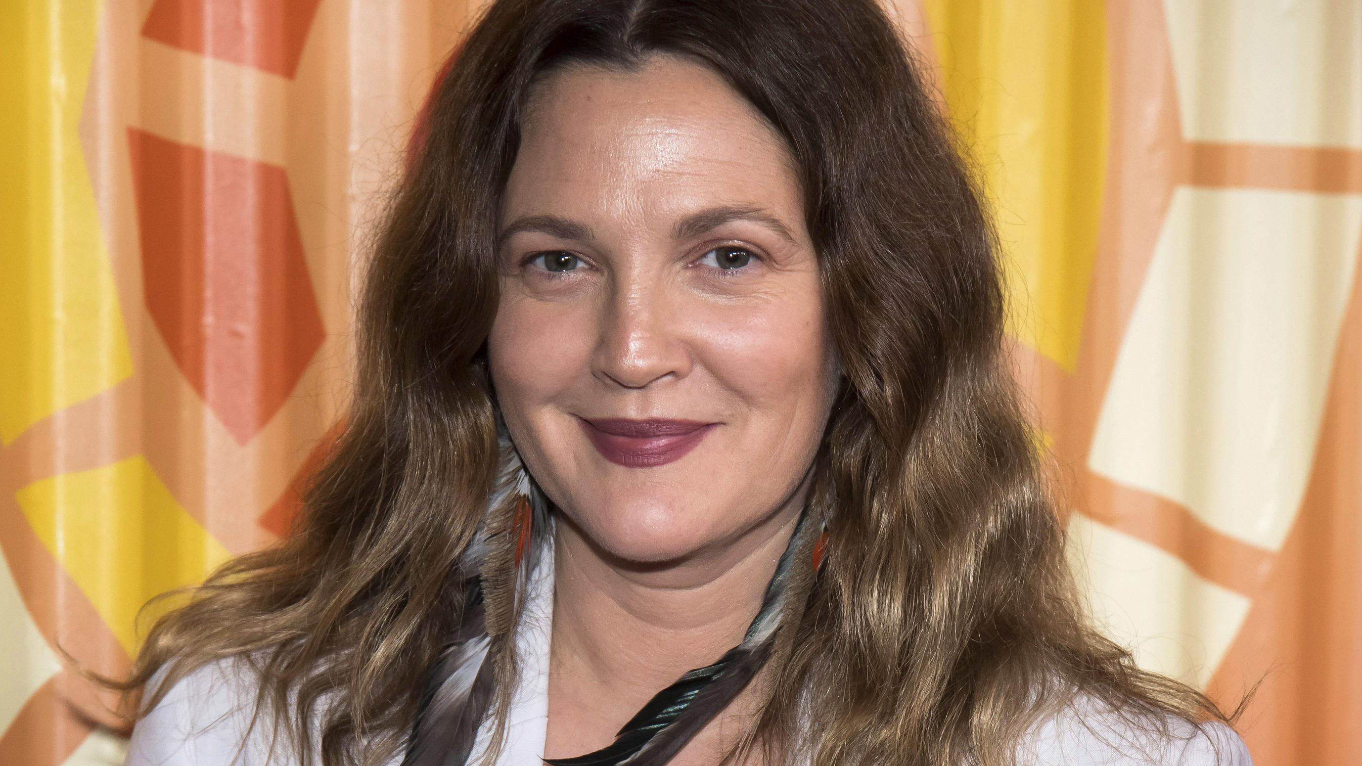 "FILE - Drew Barrymore attends The Charlize Theron Africa Outreach Project fundraiser on Nov. 12, 2019, in New York. Barrymore's first show on Monday, Sept. 13, 2020, distributed by the CBS television studio, features former ""Charlie's Angels"" co-star"