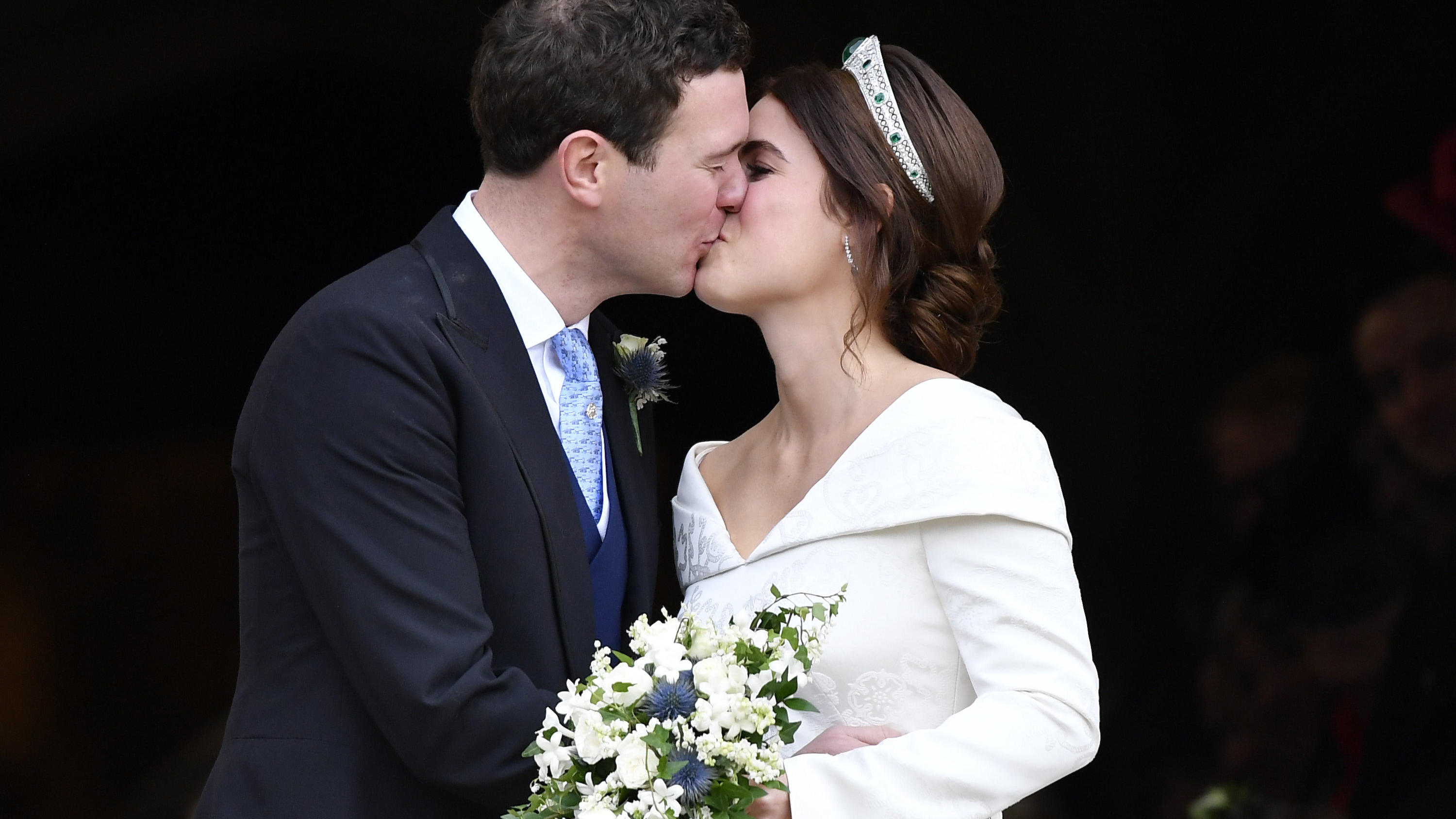 FILE - In this Friday, Oct. 12, 2018 file photo, Princess Eugenie and Jack Brooksbank kiss after their wedding at St George's Chapel, Windsor Castle, in Windsor, England. Princess Eugenie and her husband Jack Brooksbank annouced on Friday, Sept. 25,