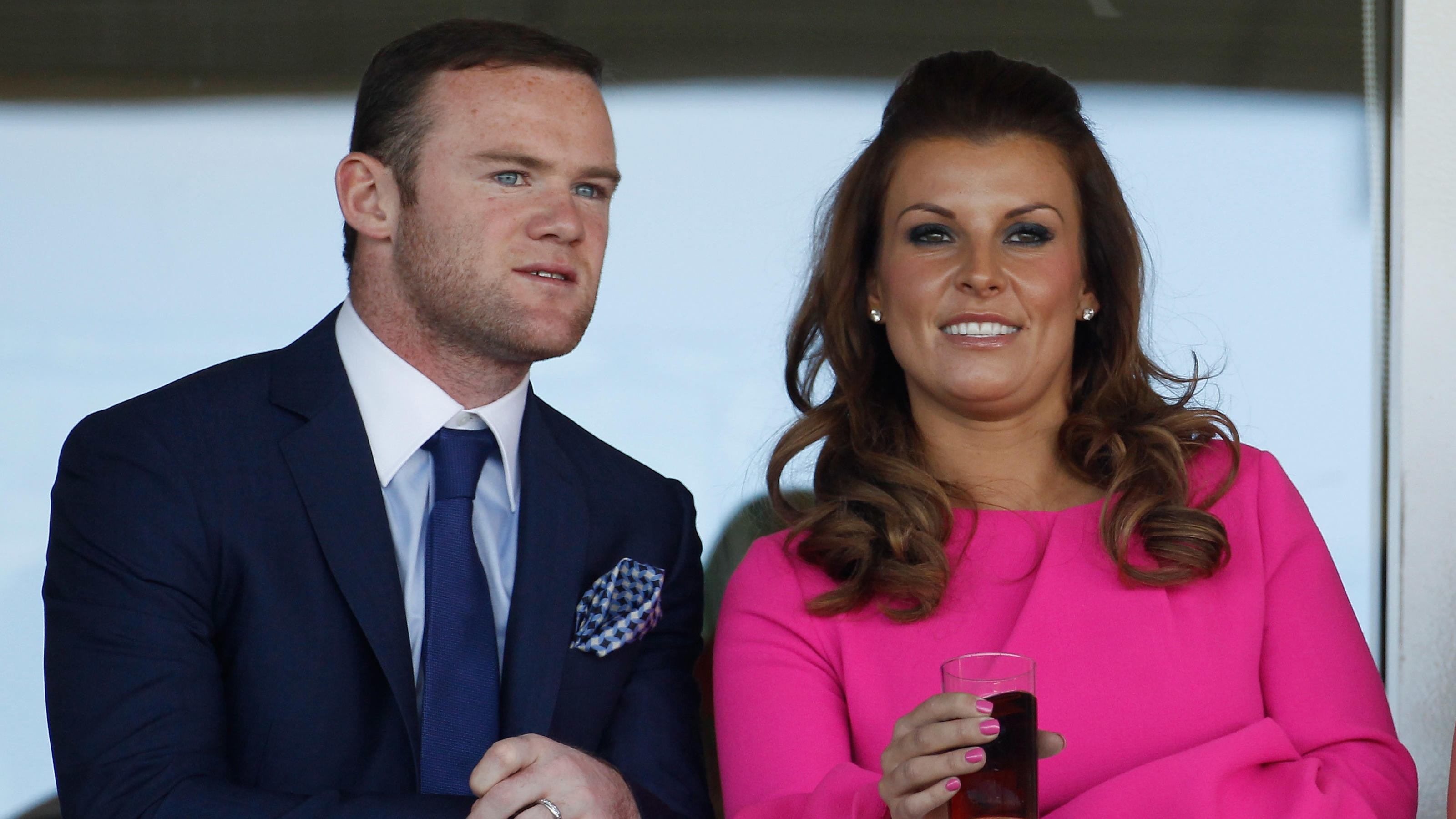 LIVERPOOL, ENGLAND - APRIL 12:  Manchester United football player Wayne Rooney and his wife Coleen watch the racing during the first day of the Aintree Grand National meeting on April 12, 2012 in Aintree, England. The first day, known as Liverpool Da