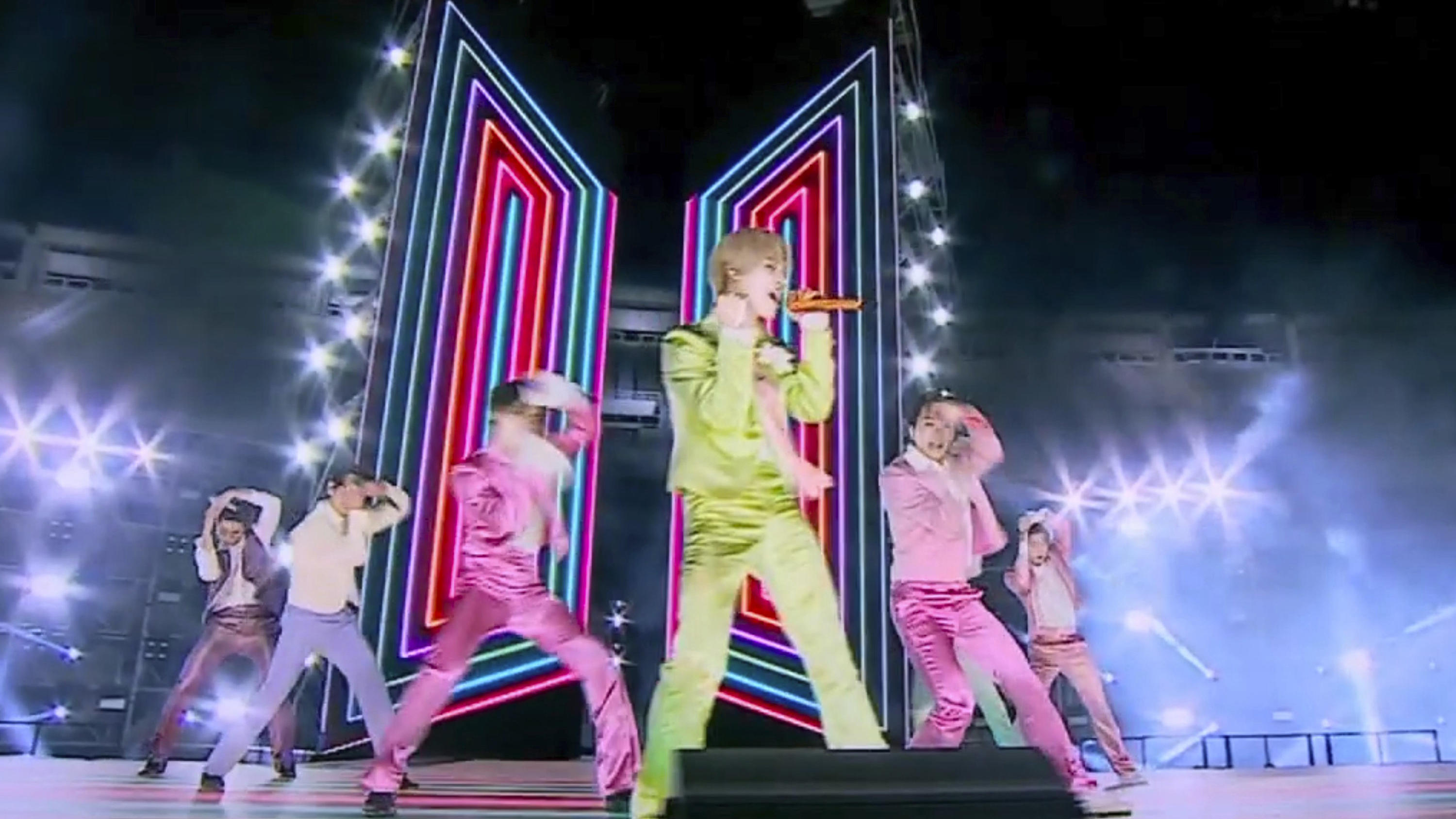 In this screen shot provided by ABC on Sunday, Nov. 22, 2020, BTS perform from Korea for the American Music Awards at the Microsoft Theater in Los Angeles. (ABC via AP)