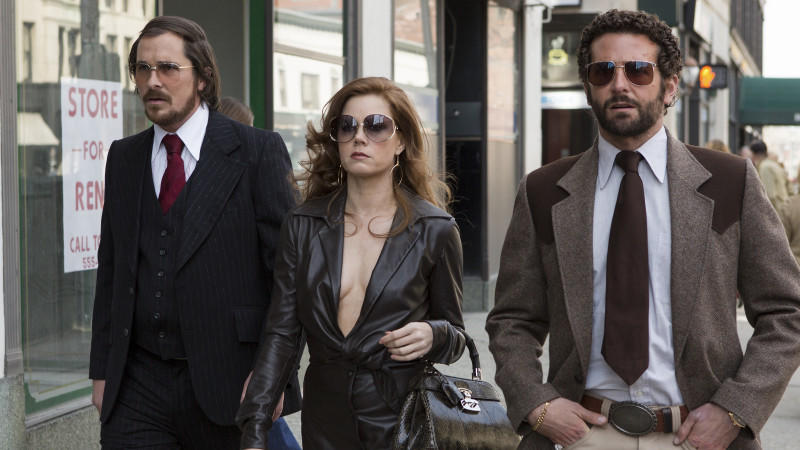 Christian Bale, Amy Adams und Bradley Cooper in 'American Hustle'.