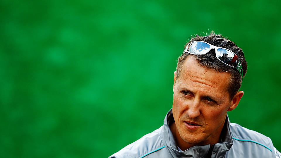 SPA FRANCORCHAMPS, BELGIUM - AUGUST 30:  Michael Schumacher of Germany and Mercedes GP is interviewed by the media during previews to the Belgian Grand Prix at the Circuit of Spa Francorchamps on August 30, 2012 in Spa Francorchamps, Belgium.  (Photo
