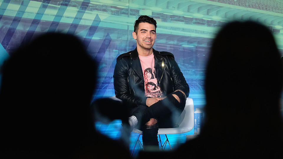 NEW YORK, NY - SEPTEMBER 26:  Joe Jonas speaks on stage during the Is Automation the New Curation? panel at the Liberty Theater during 2016 Advertising Week New York on September 26, 2016 in New York City.  (Photo by D Dipasupil/Getty Images for Adve