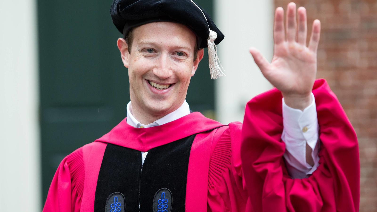Facebook founder, chairman, and CEO Mark Zuckerberg waves to the crowd at the 366th Commencement for Harvard University at Tercentenary Theatre in Cambridge, Massachusetts on May 25, 2017. Zuckerberg is receiving an honorary degree from Harvard. PUBL