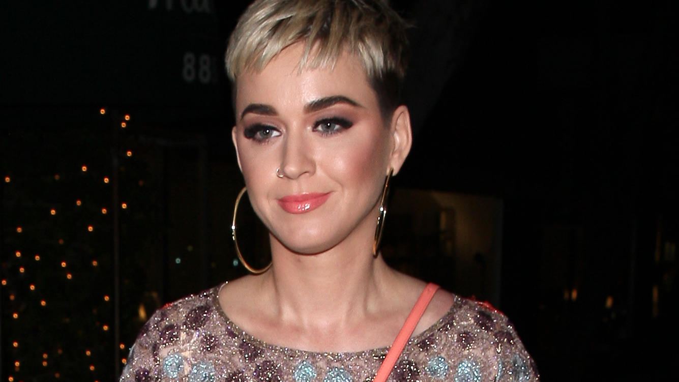 Singer Katy Perry is all smiles as she shows off her colorful dress after leaving Italian Restaurant Madeo with her friend in West Hollywood