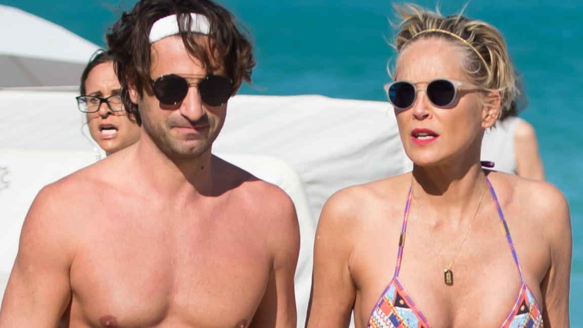 Sharon Stone is all in love with younger boyfriend during beach day in Miami one day before her 60th birthday. The love couple were seen kissing, laughing and holding hands during their afternoon on the beach in Miami.