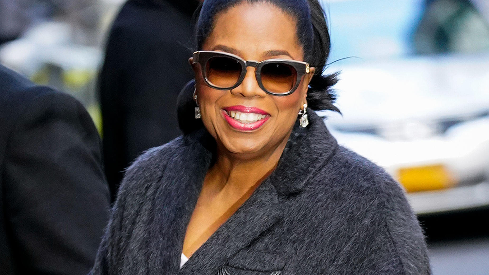 Oprah Winfrey waves hello when she arrives at Colbert show in New York