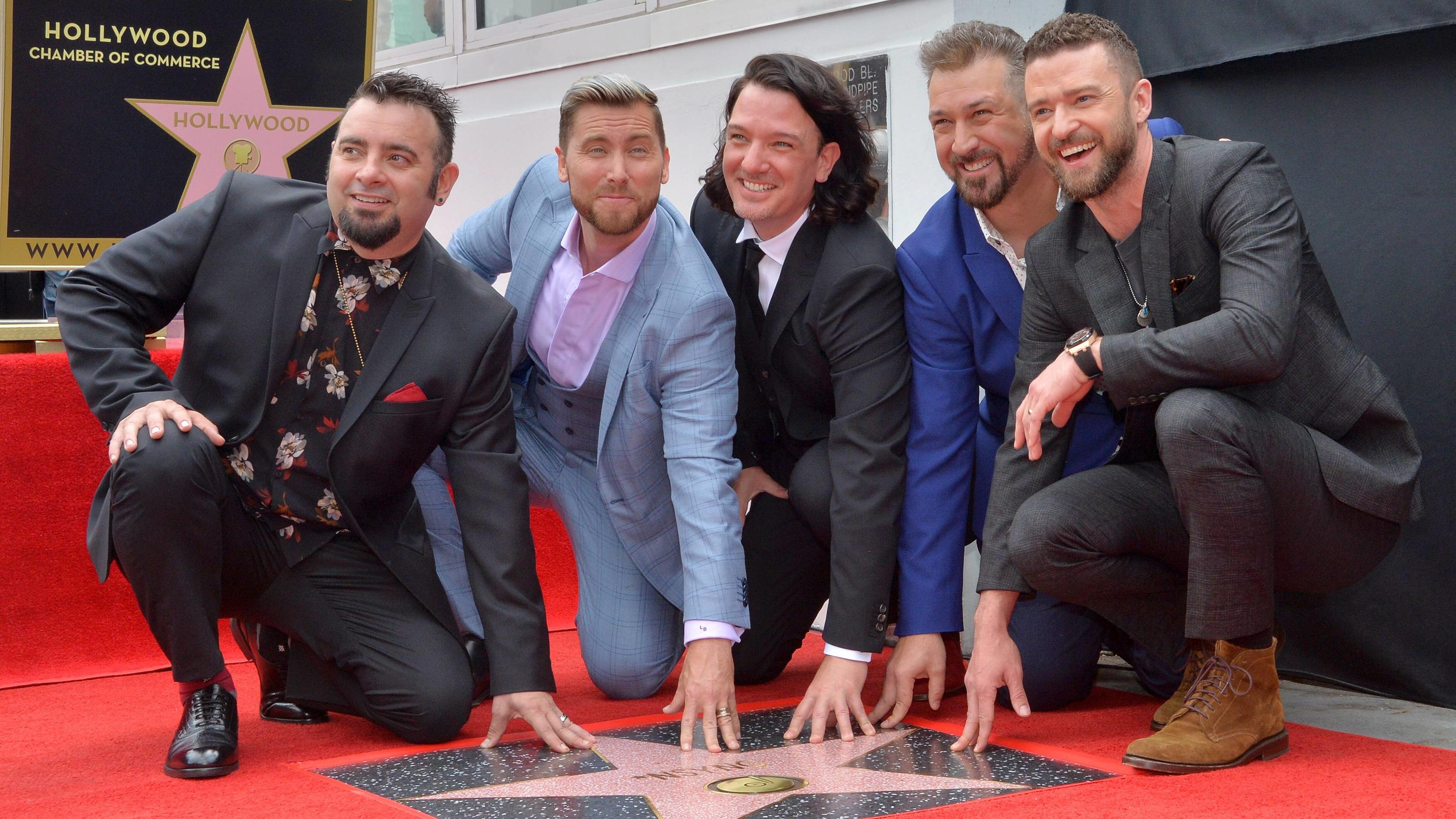 Members of the iconic 90 s boyband *NSYNC Chris Kirkpatrick, Lance Bass, JC Chasez, Joey Fatone and Justin Timberlake (L-R) gather for a photo-op as the band receives the 2,636th star on the Hollywood Walk of fame during an unveiling ceremony in Los